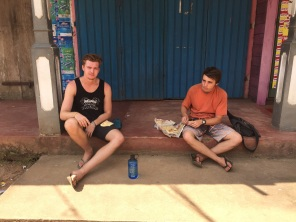 Homeless, eating some egg roti on the side of the road in Kitugala.